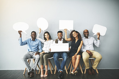 Buy stock photo Studio shot of a group of businesspeople holding speech bubbles in line against a gray background