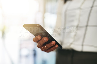 Buy stock photo Closeup shot of an unrecognizable businesswoman using a cellphone in an office