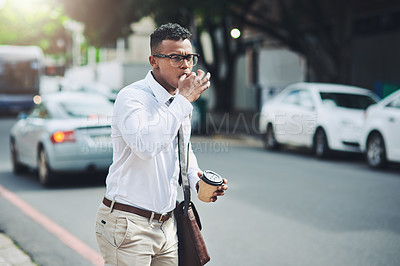 Buy stock photo Shot of a young businessman whistling to get a cab in the city