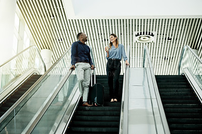 Buy stock photo Shot of businesspeople coming down the escalator at work