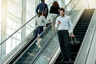 Buy stock photo Shot of businesspeople on an escalator in the workplace