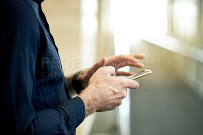 Buy stock photo Shot of corporate businesspeople in a modern workspace