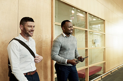 Buy stock photo Shot of two businessmen standing in a modern office