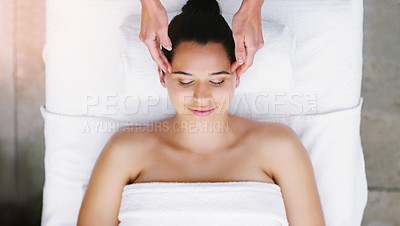 Buy stock photo High angle shot of a young woman getting a head massage at a spa