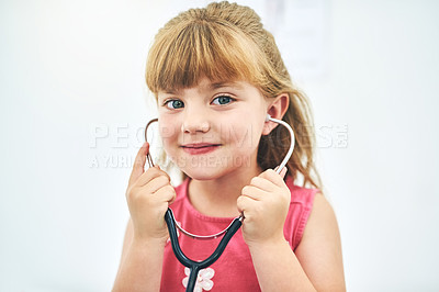 Buy stock photo Cropped portrait of an adorable little girl with a stethoscope in her ears
