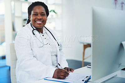 Buy stock photo Cropped shot of a female doctor working in her office