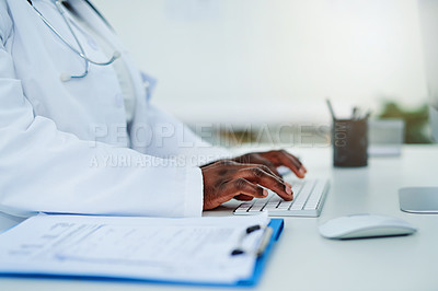 Buy stock photo Cropped shot of a female doctor working on her computer
