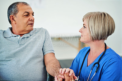 Buy stock photo Shot of a female nurse assisting a patient