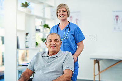 Buy stock photo Shot of a female nurse seeing a patient in wheelchair