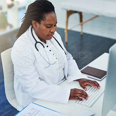 Buy stock photo Cropped shot of a female doctor working on her computer in her office