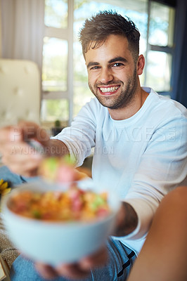 Buy stock photo Portrait of a young man offering you cereal