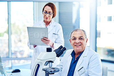 Buy stock photo Portrait of two scientists working together in a laboratory
