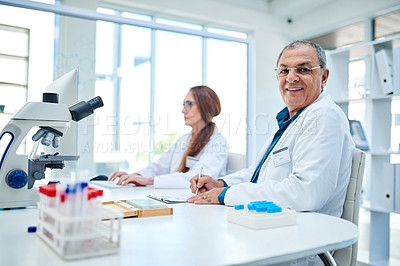 Buy stock photo Portrait of two confident mature scientists working together in a laboratory