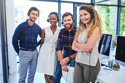 Buy stock photo Portrait of a team of confident young people working together in a call centre