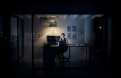 Buy stock photo Full length shot of an attractive young creative businesswoman working on a computer in her office