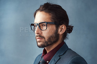 Buy stock photo Studio shot of a handsome young man looking thoughtful against a grey background