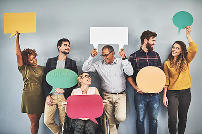 Buy stock photo Shot of a group of businesspeople holding up speech bubbles