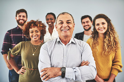 Buy stock photo Shot of a group of businesspeople standing together