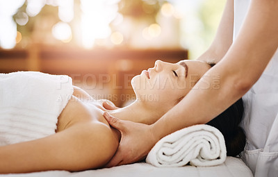 Buy stock photo Cropped shot of a beautiful young woman getting a massage at a spa
