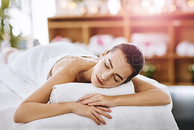 Buy stock photo Closeup shot of a young woman relaxing on a spa bed