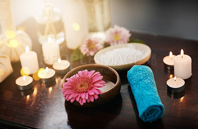 Buy stock photo Shot of various spa essentials arranged on a table