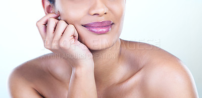 Buy stock photo Cropped studio shot of a beautiful young woman posing against a light background