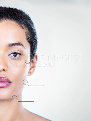 Buy stock photo Conceptual studio shot of a beautiful young woman posing against a light background