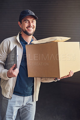Buy stock photo Portrait of a courier holding packages for delivery