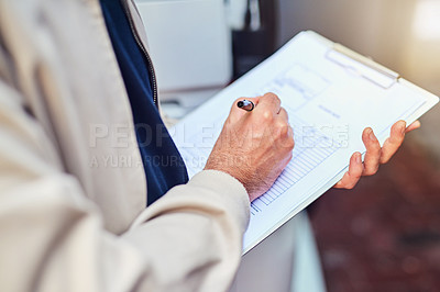 Buy stock photo Closeup shot of a courier using a clipboard