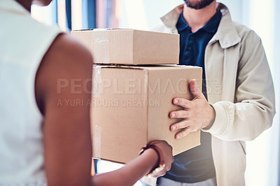 Buy stock photo Closeup shot of a courier making a delivery to a businesswoman at her office