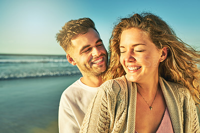 Buy stock photo Cropped shot of an affectionate young couple sharing an intimate moment on the beach