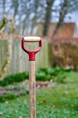 Buy stock photo A shovel waiting to be used in the garden