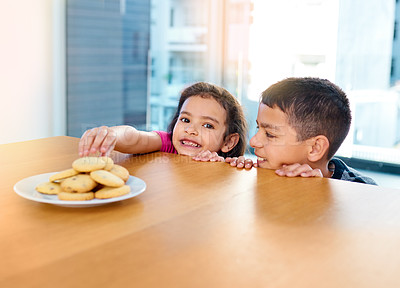 Buy stock photo Shot of a little brother and sister at home