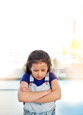 Buy stock photo Shot of a sad little girl posing eyes closed and with arms folded at home