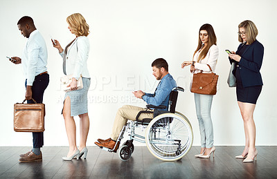 Buy stock photo Studio shot of a group o focused people in a row behind each other against a white background