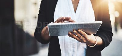 Buy stock photo Closeup shot of a businesswoman using a digital tablet in the city