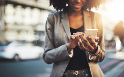 Buy stock photo Closeup shot of a businesswoman using a cellphone in the city