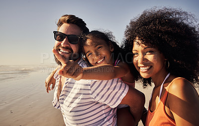 Buy stock photo Portrait of a happy family spending time at the beach