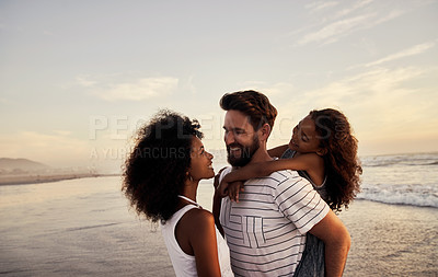 Buy stock photo Shot of a happy family spending time at the beach