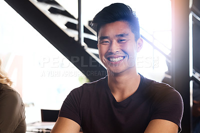 Buy stock photo Cropped portrait of a confident and handsome young designer sitting in his office