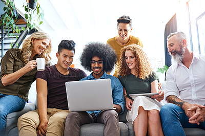 Buy stock photo Cropped shot of a group of designers working together on a laptop in an office