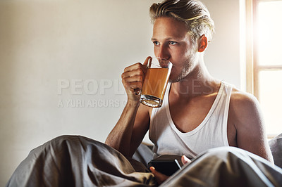 Buy stock photo Cropped shot of a handsome young man relaxing in bed