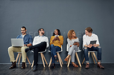 Buy stock photo Full length shot of a group of businesspeople waiting in line for a job interview