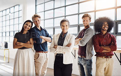 Buy stock photo Portrait of a team of happy designers posing confidently in their modern office