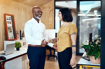 Buy stock photo Shot of two designers shaking hands in an office