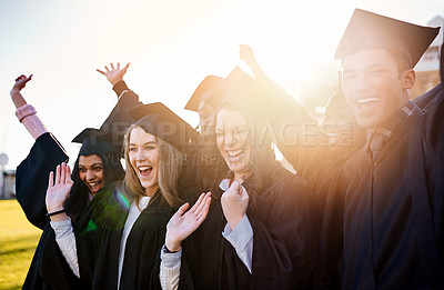 Buy stock photo Shot of a group of students standing together on graduation day
