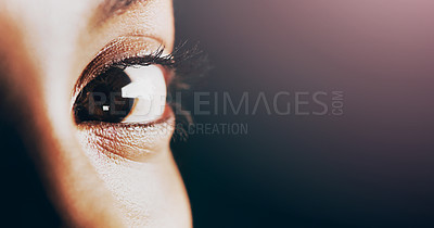 Buy stock photo Closeup shot of a beautiful young woman's eye against a dark background