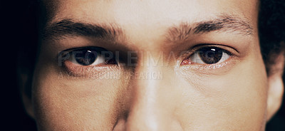 Buy stock photo Studio portrait of a man opening his eyes against a dark background