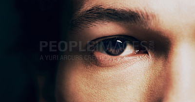 Buy stock photo Closeup shot of  man opening his eyes against a dark background
