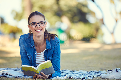 Buy stock photo Shot of an attractive young woman spending the day outdoors